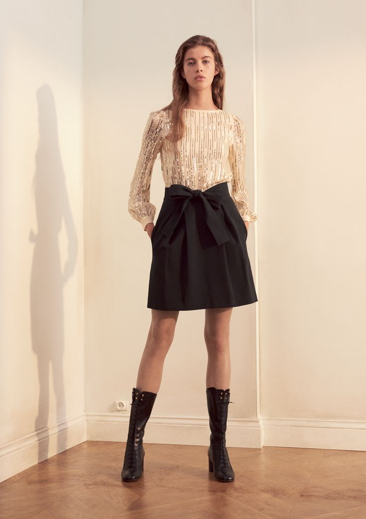 Shiny fabrics and romantic details define our PADRE blouse and PABLO skirt. Add an edgy touch with our ABETAIA boots.