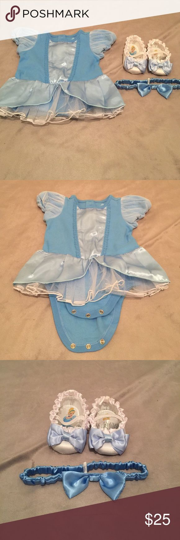 Baby, Cinderella costume. Official Disney baby. Baby costume, complete with shoes and headband accessory. 100% organic cotton. 100% polyester. New! Worn only for a picture (as shown). Great for a Cinderella theme party, Disney princesses party, Halloween costume, or any day to play dress up with your princess! Makes a great gift! Costumes Halloween
