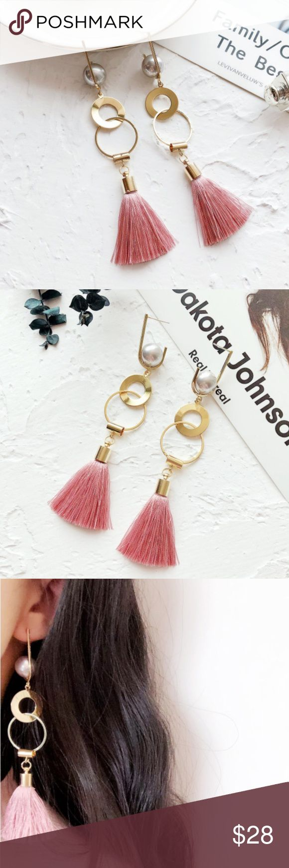 "Pink Tassels Gold Hoops Geometric Drop Earrings These dangle earrings are very trendy and include various gold hoops, a white faux pearl and pink tassels as pictured. Makes a great statement piece!  Pink tassel earrings measure 4.75"" in length and the largest hoop width measures approximately .75"".  Let me know if you have any questions. Happy to help. :) Trendy Jewels Jewelry Earrings"
