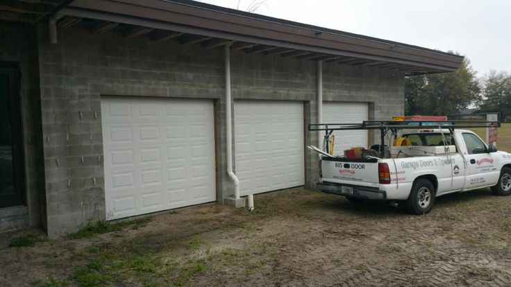 New traditional steel garage doors by Overhead Door Company of Tampa Bay. These 9x7 series 170 #garagedoors were the perfect choice at The Champions' Club in Trinity.