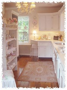 Adorable Shabby chic kitchen. So, so pretty. I am definitely going to have a pink kitchen. And maybe a pink living room. Maybe I'll make everything pink.