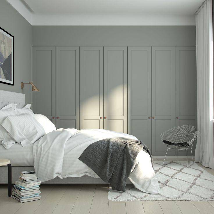Cozy bedroom with A.S.Helsingö wardrobe. ENSIÖ wardrobe doors on IKEA PAX cabinet frames. PARASOL handles in copper. More