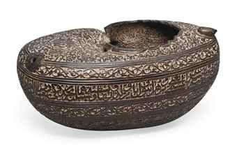 A CARVED COCO-DE-MER BEGGAR'S BOWL (KASHKUL) QAJAR IRAN, 19TH CENTURY