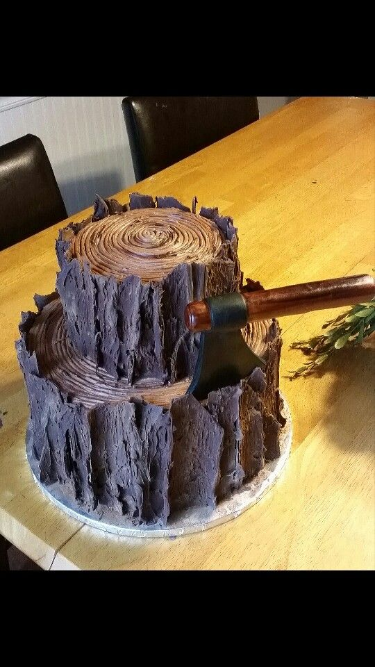 Two tier tree stump/log cake; perfect for a lumberjack party. Fondant ax. Tree bark detail.