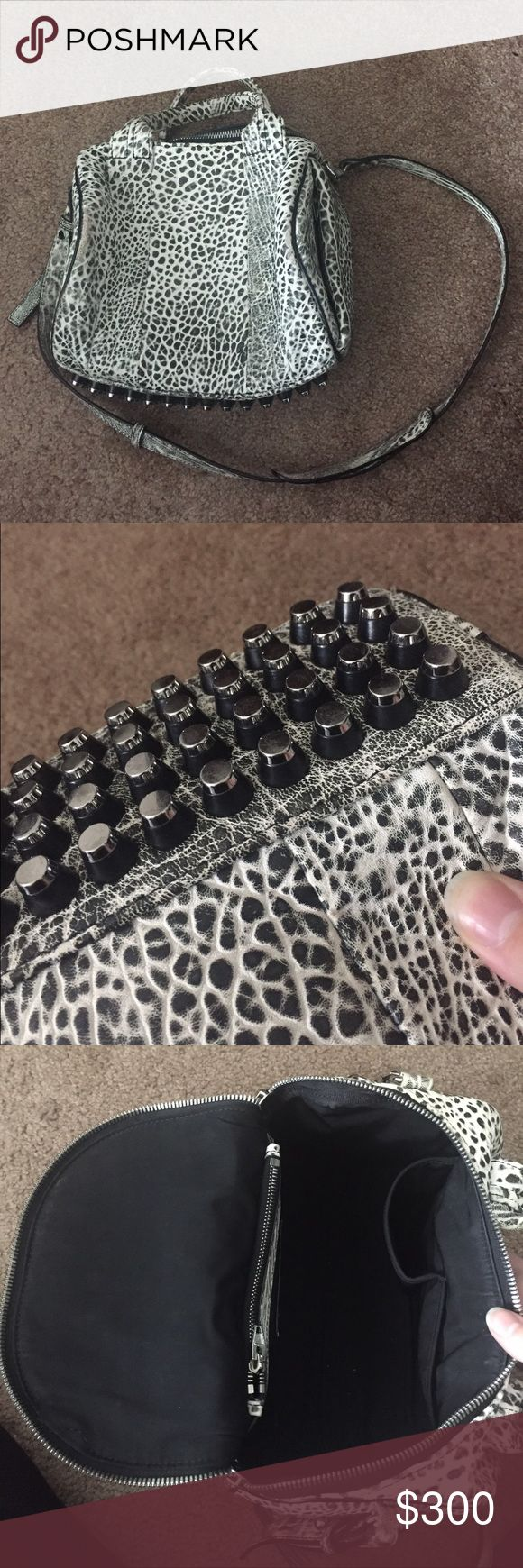 Alexander Wang Rockie Dumbo Good used condition. Black and white crackle with black and silver bottom studs. Some wear on edges as shown. This pattern is great to disguise that wear - not noticeable. Rest of bag looks good. Inside is like new, very clean. Great size bag. No trades, no pp. accepting offers! Alexander Wang Bags