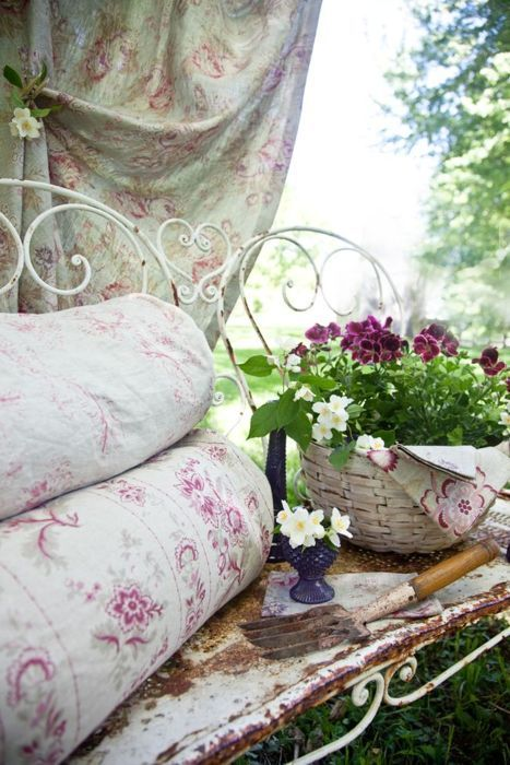 iron benches w/pretty fabric & baskets of flowers & a bit of shade....