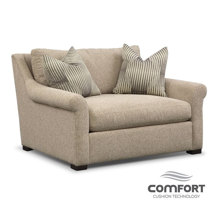 Mother-Approved. The Robertson Comfort chair and a half from Ultimate Comfort by Kroehler™ has just the kind of timeless good looks and long-lasting construction that even a mother would approve of. Gently sloped and subtly rolled arms are as warm and inviting as the creamy oatmeal-colored upholstery. This furniture collection is made by hand with a reversible cushion for convenience and durability.