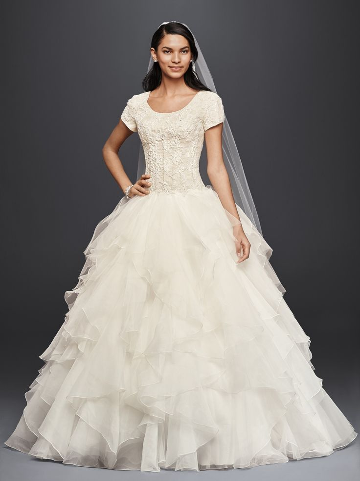 A modest wedding dress fit for a princess oleg cassini for Petite wedding dress designers