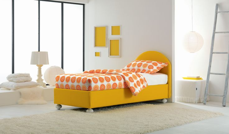 Facile c is a single storage bed with a bright yellow upholstery ...