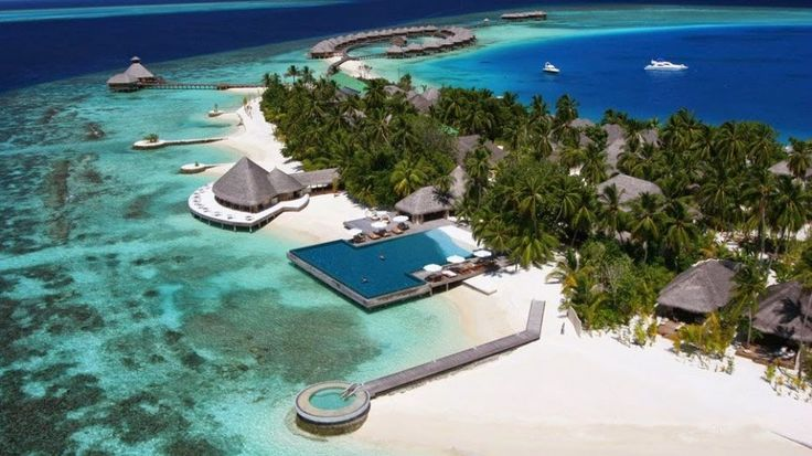 """Huvafen Fushi Resort, Maldives - translates locally to """"dream isle"""" - this beautiful private island is just 30 minutes away from an International Airport by speedboat. The grand bungalows have an astounding view of the world's first underwater spa, as well as private pools. Image source: .spbdelarte.ru"""