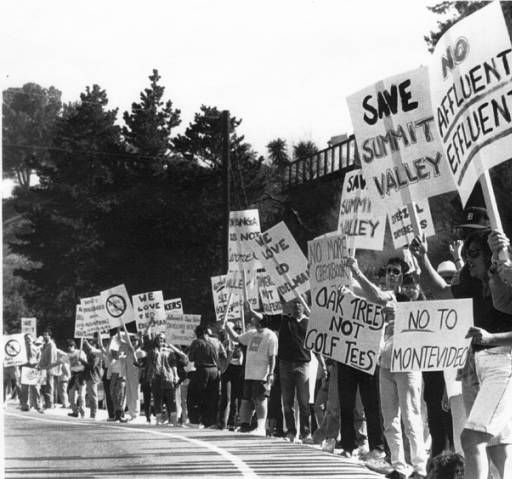 A rally in Topanga to protest the Montevideo housing development project in Summit Valley, 1991. The Montevideo housing venture was first formed in 1982 to build luxury homes and a golf course on 660 acres at the top of Topanga Canyon Road. After 12 long years of struggle, the Santa Monica Mountains Conservancy purchased the land from Canyon Oaks Estates Ltd. and created Summit Valley Edmund D. Edelman Park. Topanga Historical Society. San Fernando Valley History Digital Library.