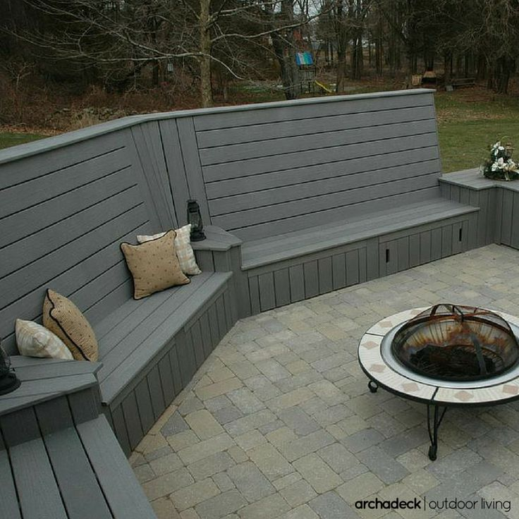 Gray composite deck with high back built in benches for for Decking at end of garden