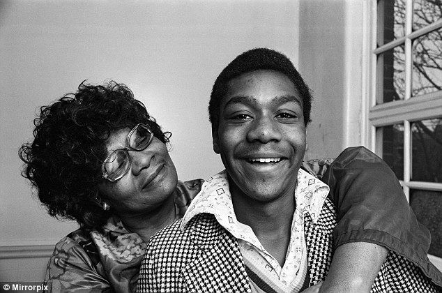 Mummy's boy: Comedian and actor Lenny Henry, pictured in 1975 with his mother, after being announced as the winner of competition New Faces