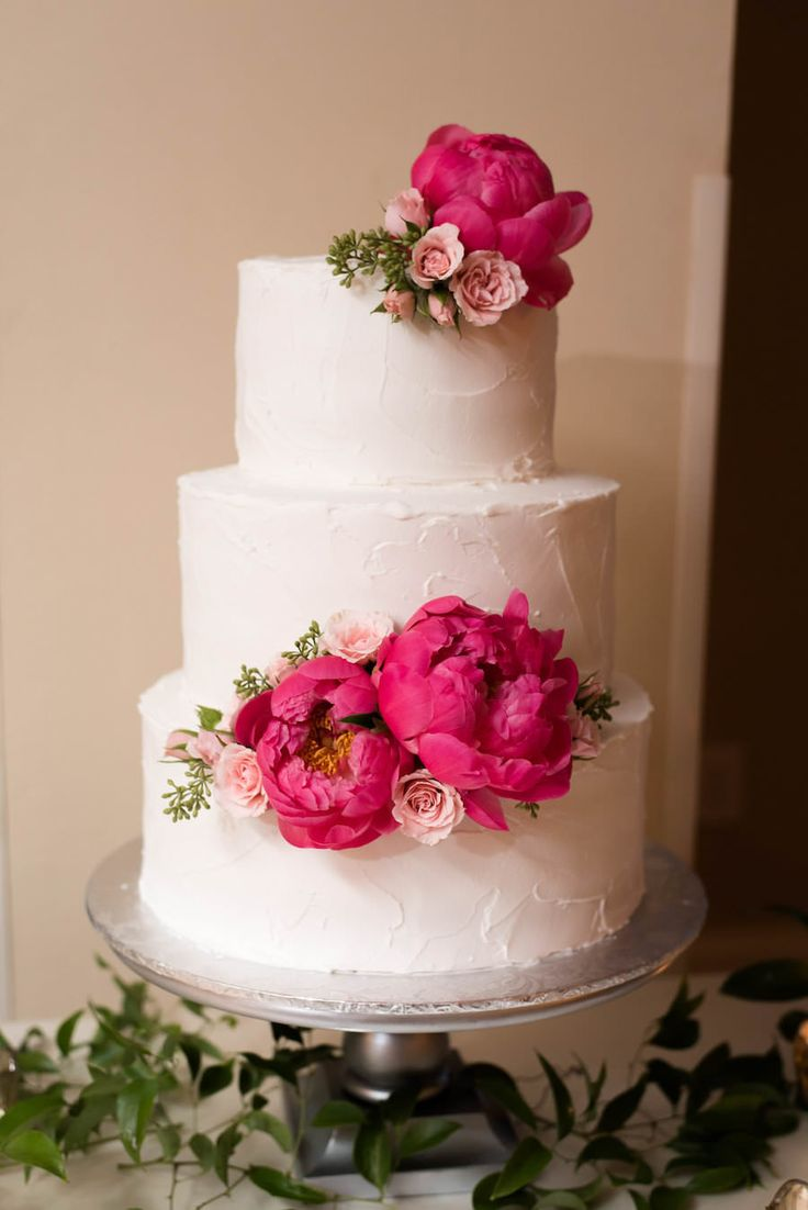 Three Tiered Round White Wedding Cake With Pink Peony Accents