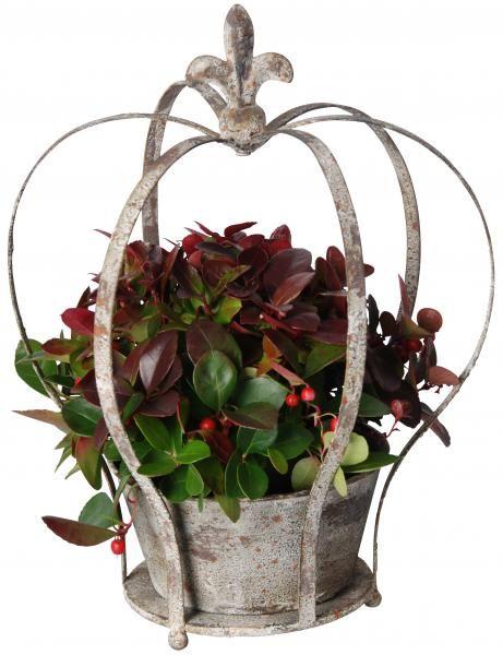 Korona formájú antik fém virágcserép szett, 3 darabos. A tartó egyik szára elfordítható, így a kaspó könnyen kivehető.