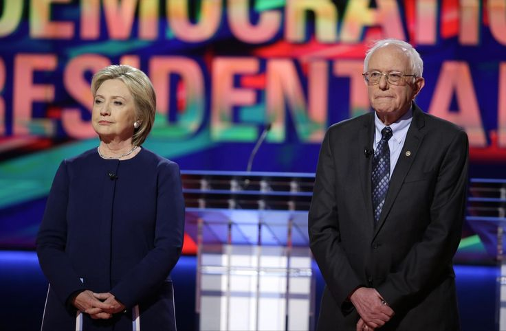 Associated Press: Democratic presidential candidates Hillary Clinton, left, and Sen. Bernie Sanders, I-Vt., stand on stage before a Democratic presidential primary debate at the University of Michigan-Flint, Sunday, March 6, 2016, in Flint, Mich. (AP Photo/Charlie Neibergall)...