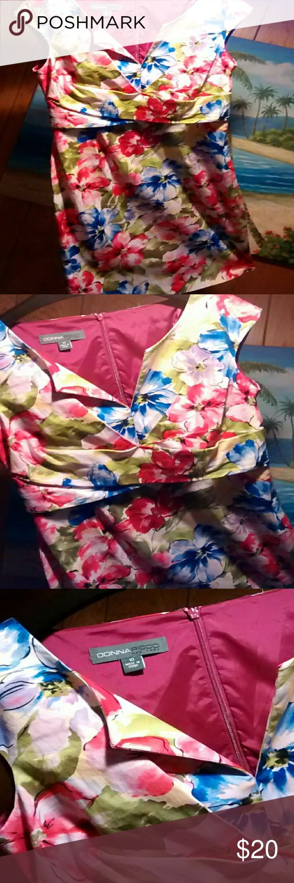 Donna Ricco size 10 floral dress. Pretty sleeveless floral dress. Front goes to a v, and there is a band at the waist.Waist measures about 32inches. Length in back is 39inches.  Hidden zipper in back. Blue, green, pink, yellow, lavender and white in color. Donna Ricco Dresses