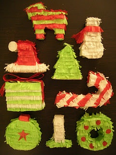 my sister made these little mini pinatas to string up for christmas eve when her family has a mexican feast! LOVE it!