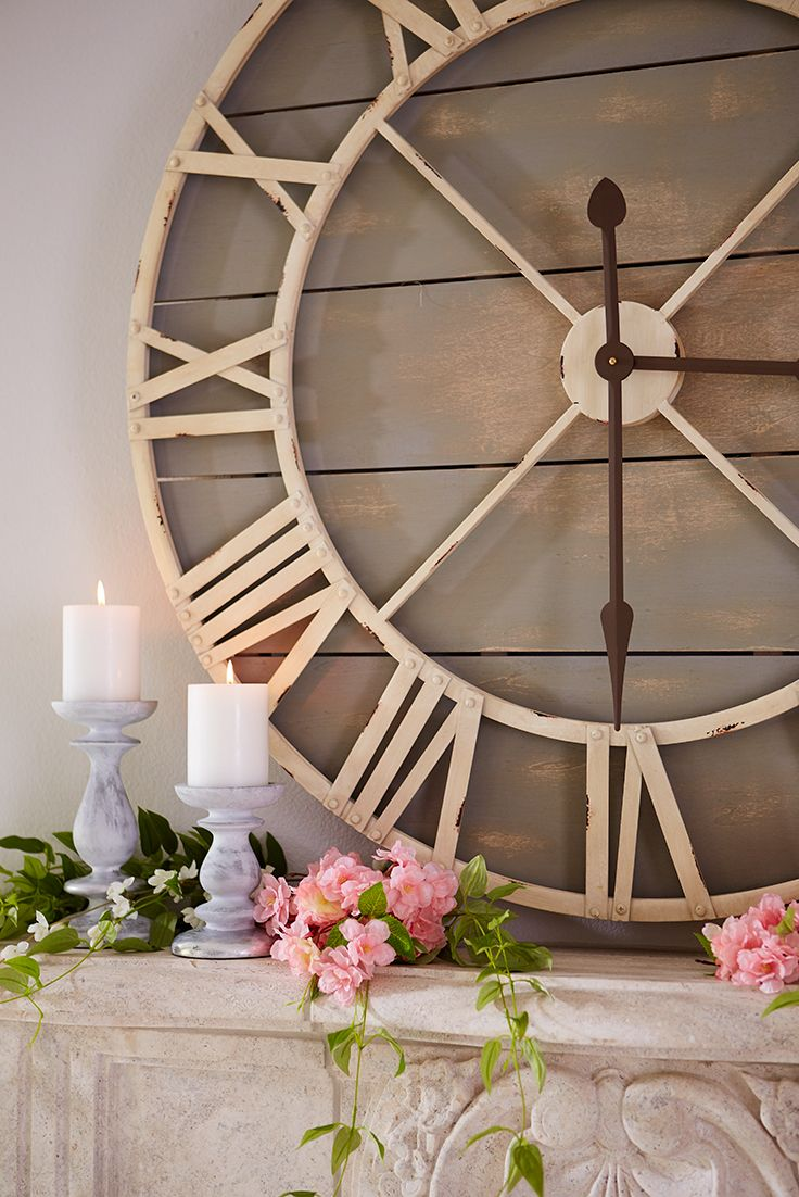 Why not show off your fabulous taste around the clock? Hang Pier 1's hand-painted wood and wrought iron Oversize Gray Rustic Wall Clock, and let it keep pace just like you do—stylishly.