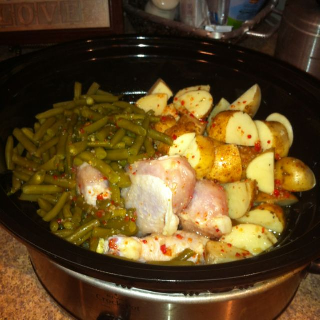 Crockpot Italian 3 in 1! 4 frozen chicken breast 2 cans green beans 6 small potatoes 1/2 bottle Italian dressing or more to liking. Cook on high 4-6 hrs until chicken and potatoes are done!