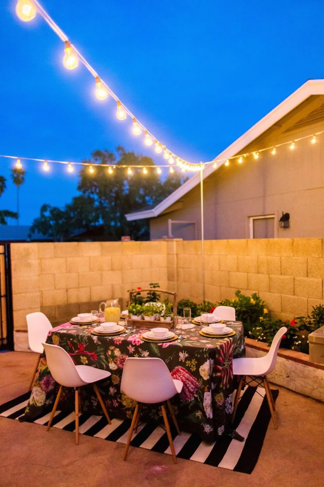 String lights create the perfect setting for an outdoor meal.