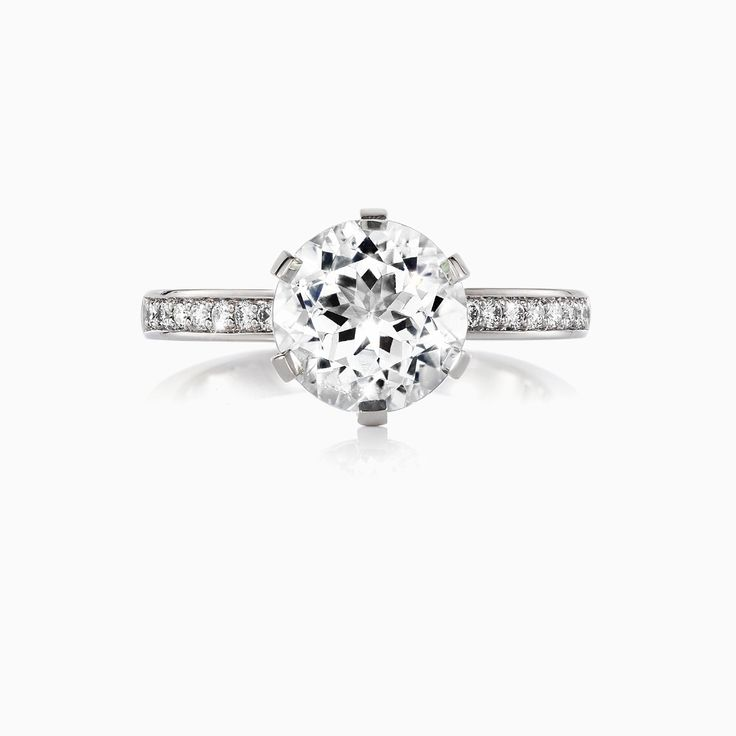 The Crown solitaire engagement ring with White Topaz