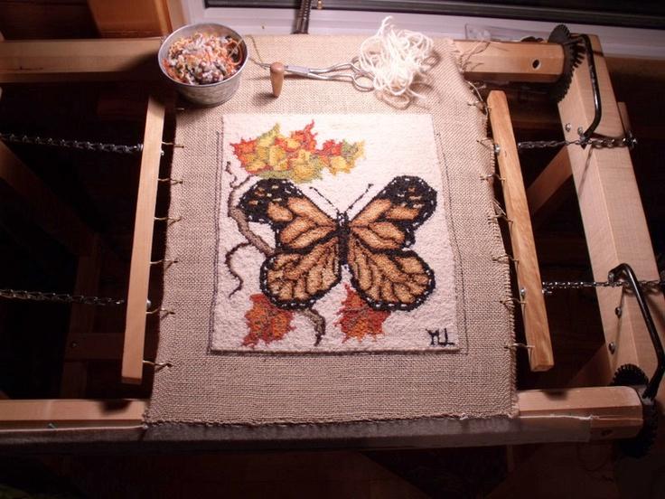 Hooked Butterfly done by Yvette LeLièvre. (Fine 2-ply wool yarn on premium burlap)