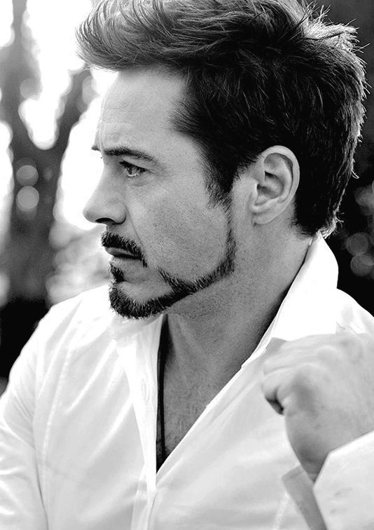 Robert Downey Jr. Iron man!!!!! I think he's the only man in the world that I actually love facial hair on!