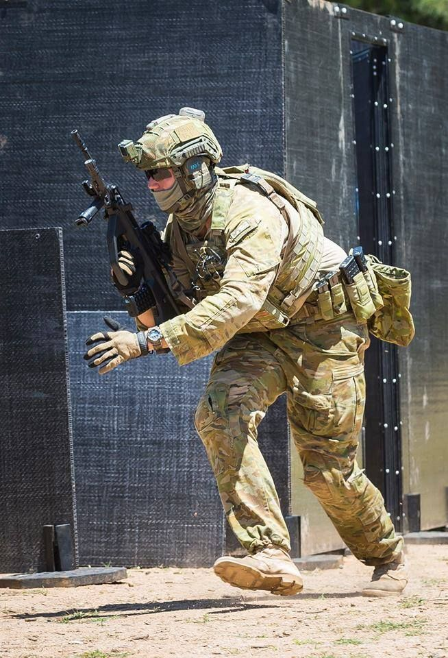 Photo Credit to Australian Defence Force Photography Australian Army soldier Corporal Karl Fabreschi from 2nd Battalion, The Royal Australian Regiment, moves to a firing position during the combat shooting skills training activity at Majura training area outside Canberra on 30 November 2016.