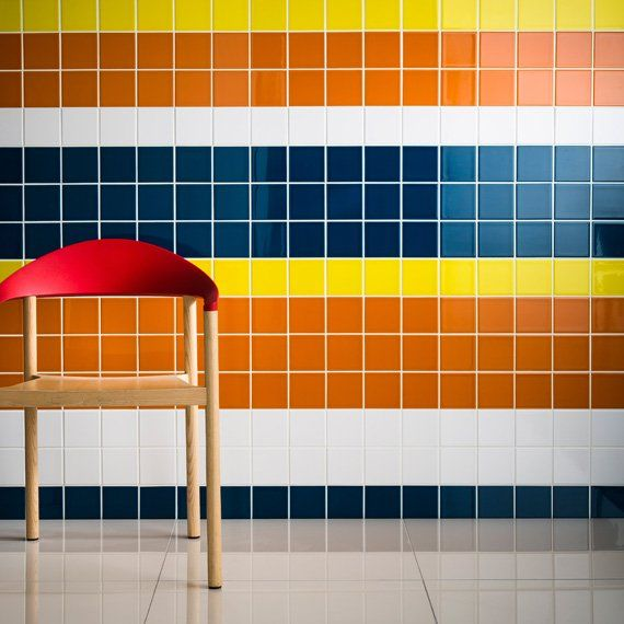 Johnson Tiles — Prismatics are the best option for loads of colours, cheap too. Various shapes - square or brick.