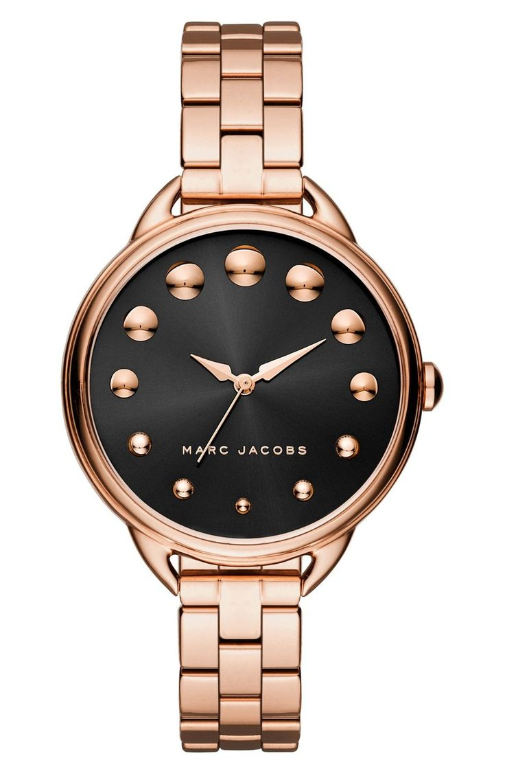 Swooning over this combination of rose gold and black from Marc Jacobs! Gleaming stud indexes wax and wane over the dark dial of this elegant round watch.