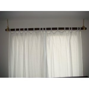 Easy Breezy Bamboo Curtain Rod No need to splurge on this one... 1. Grab a piece of bamboo desired length in either your backyard (if available :)) OR your local Home store or Craft Store 2. Slip on curtain or you can get the rings with clips to use to hang curtain or fabric. 3. I used rope to hang rod from ceiling but you can also use simple curtain rod holders, just make sure big enough to fit around bamboo : )