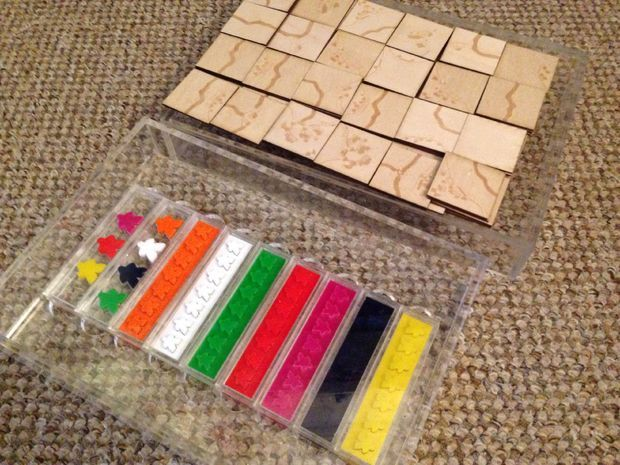 Wooden Carcassonne board game.                                                                                                                                                                                 Mais