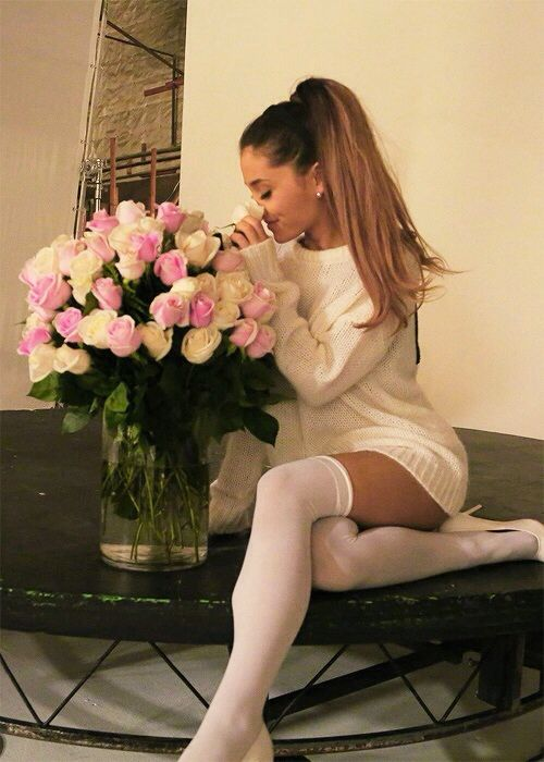 Do innocent and sweet with a dash of slutty in white thigh high socks, heels and a slightly oversized fluffy knit.