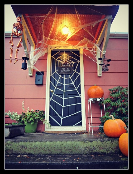 Masking tape spiderweb on your front door. Costs less than a dollar to make! #halloween