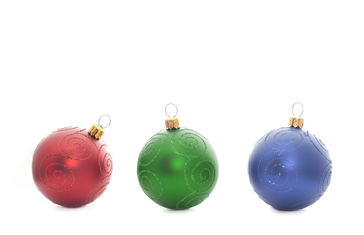 rouge vert bleu | Red, green and blue baubles in a row on a white background with ...