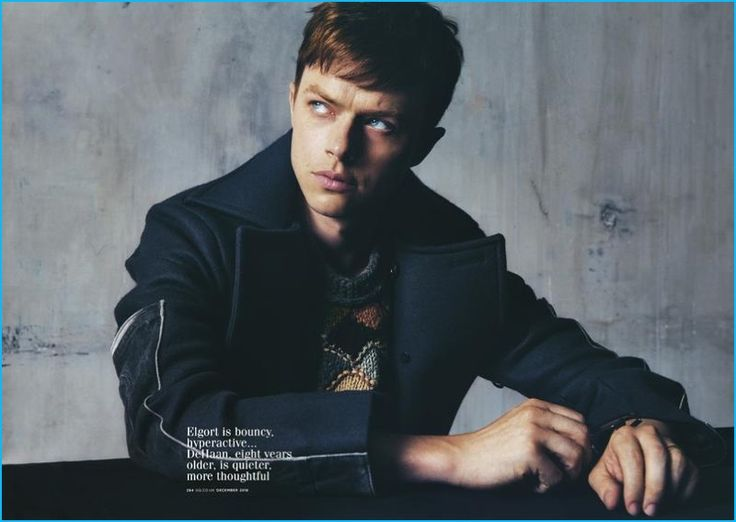 Dane DeHaan sports a tailored coat and intarsia wool sweater from Prada.