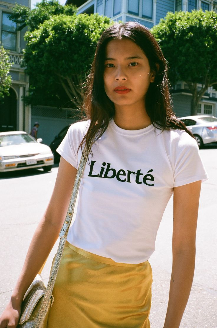 """Freedom, freedom, freedom. We'll never get tired of saying it and we'll  never stop seeking it. Pair the """"Liberté"""" tee with jeans for a casual look  or under a blazer and trousers to dress it up.By L'Ecole Des Femmes     * 95% Cotton     * 5% Lycra --Measurements Size S:Length: 22&qu"""