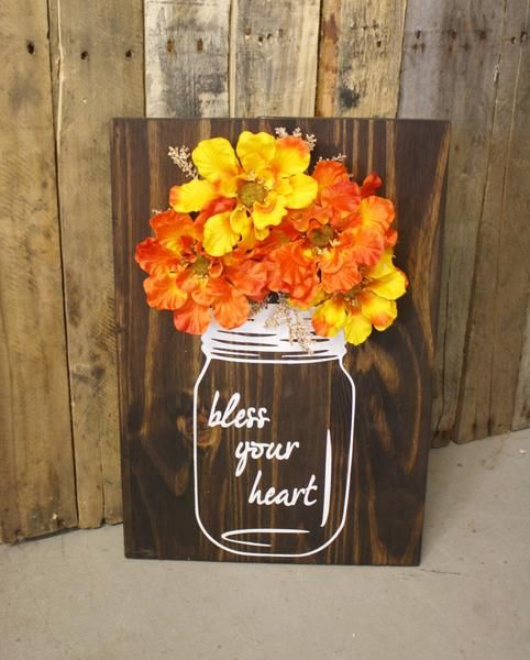 """These Mason Jar Decorations have a rustic finish and 3D floral accents with """"Bless Your Heart"""" quote. This rustic home decor can be made with your choice of cus"""