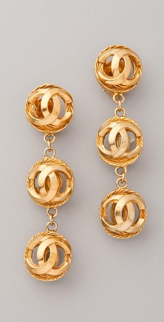 Vintage Chanel CC Ball Earrings http://rstyle.me/n/bqgj8nrm5w These authentic vintage Chanel gold-plated clip-on dangle earrings feature interlocking Cs at the ball details.