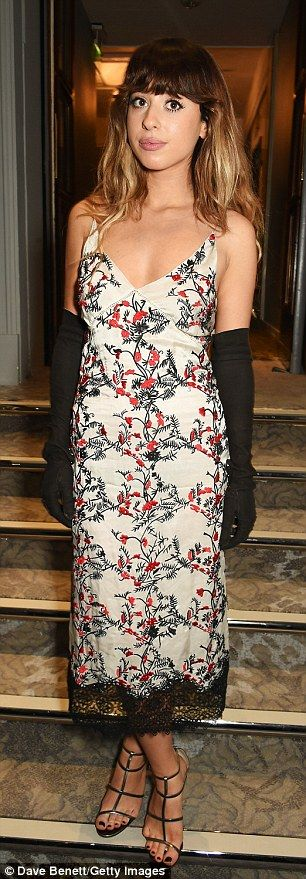 Glam girls: Foxes opted for a ladylike, floral print slip with long suede gloves