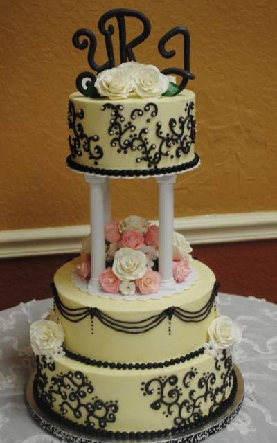 3 Tier Round Wedding Cakes | tier ivory round wedding cake with Roman pillars and black script ...