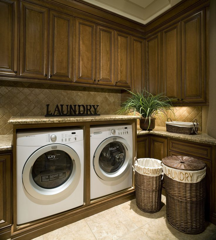 we love this laundry room its contemporary in style with a front load washer and