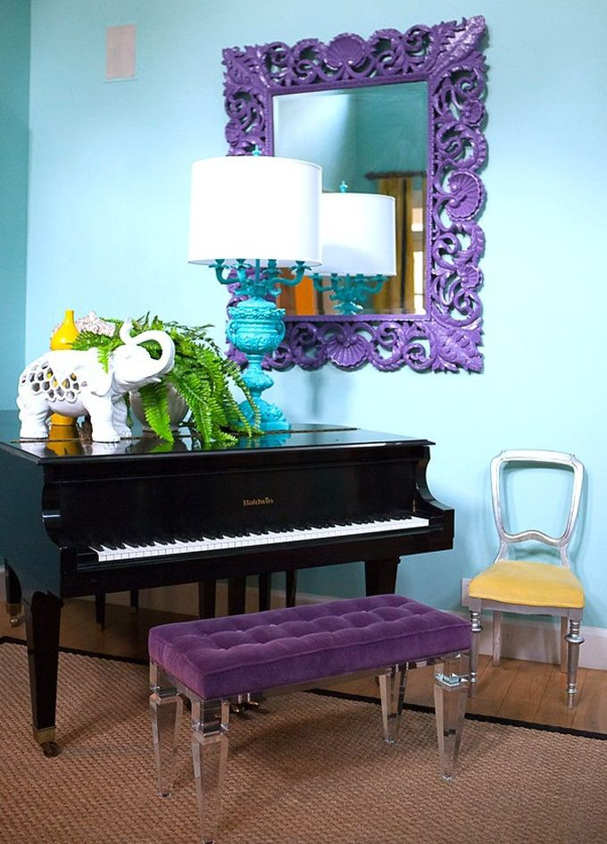A black baby grand piano is inherently formal. It can be used fine in contemporary spaces, but not in informal, bohemian, wild colored ones. It's an insult to such a dignified piece to have these clearly out of place objects around it. Please remember to keep your mood consistent to achieve a harmonious look.