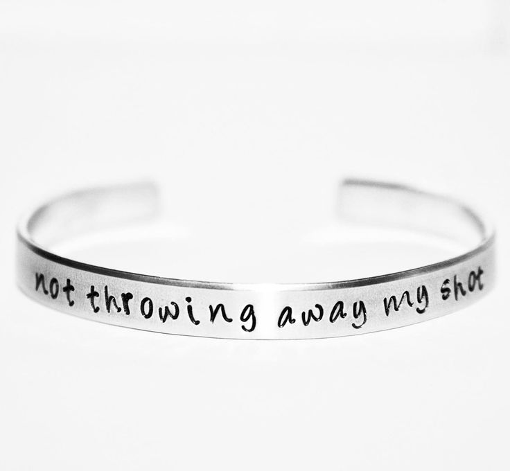 "Hamilton inspired ""not throwing away my shot"" Bracelet 1/4"" wide 6 inch long aluminum cuff bracelet. The metal is durable yet soft enough to shape it to your own wrist. Each piece is hand-stamped and"