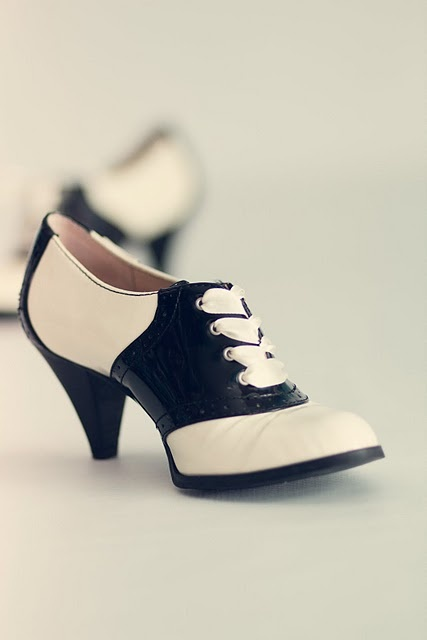 I adore these shoes. I just want to go bowling then to a sock hop!