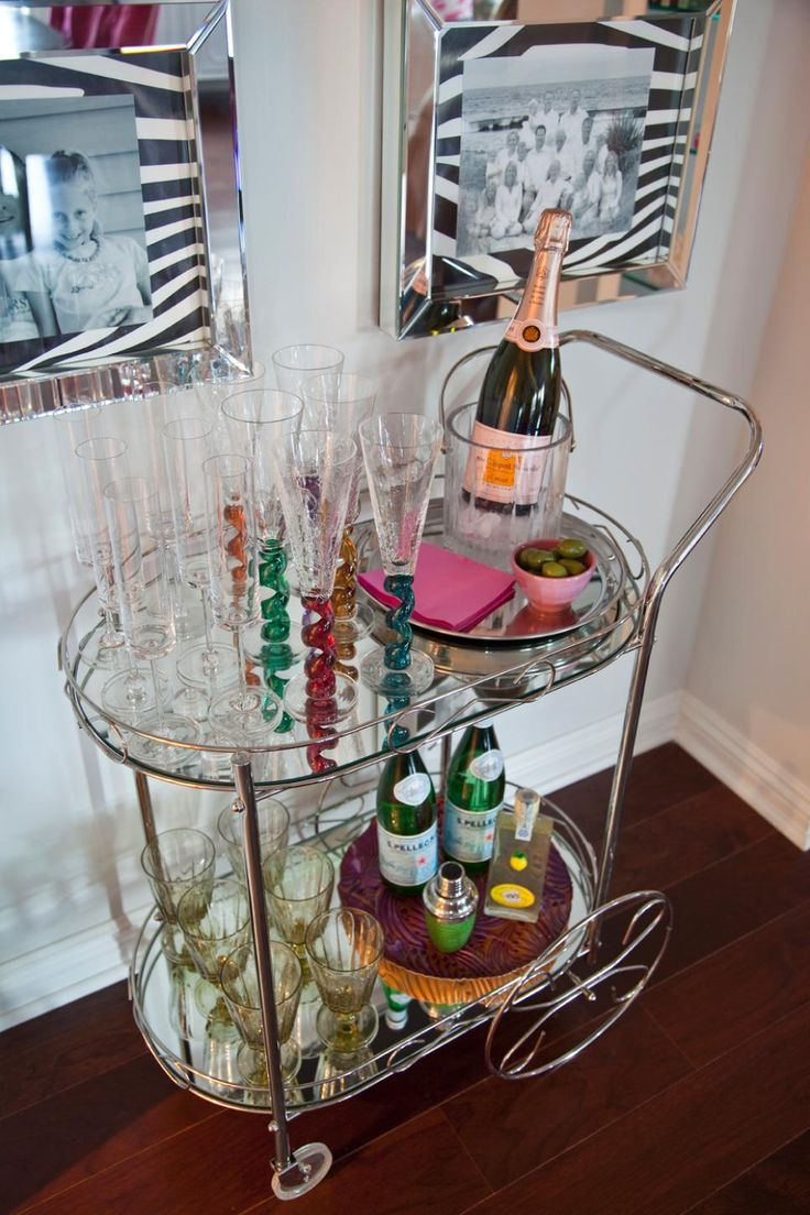 This chic metal bar cart is a fun way to display pretty drinking glasses in the dining room. The mobile cart also adds a touch of glam to the neutral space.