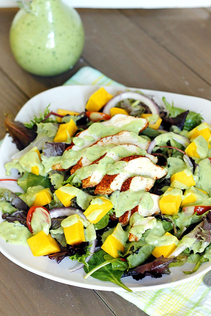 A healthy, flavorful, and filling Blackened Chicken and Mango Salad with just the right amount of tangy, Creamy Avocado Dressing!