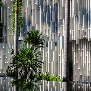 Vietnam spa by MIA Design Studio features latticed walls, hanging gardens and pools of water