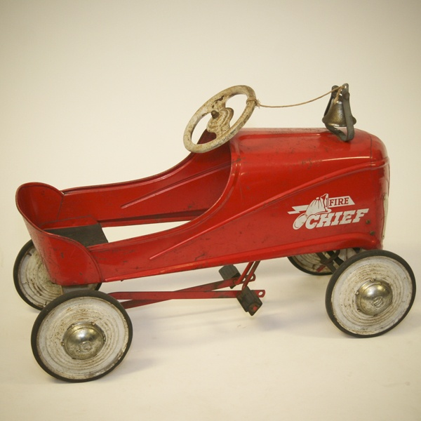 """Vintage red Murray """"Fire Chief"""" pedal car with bell."""